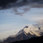 The peaks of Mount Illimani are showing through the melting ice.