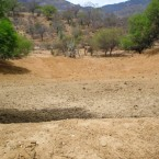 An empty resevoir with a view of the parched surrounding landscape. (Photo from the Pasorapa mayor's office)