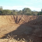 This articifical lake or resevoir, designed to collect water, is completely dried up. (Photo from the Pasorapa mayor's office)